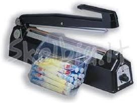 Impulsiniai maišelių užlydymo (pakavimo) aparatai,